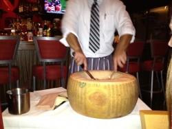risotto prepared in a cheese wheel