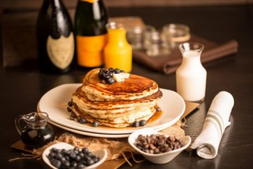 Rustic Root Brunch - Fluffy buttermilk pancakes with blueberries and optional but recommended chocolate chips